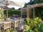 Pergola provides kitchen area and shaded seating space