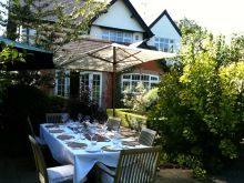 White linen and glass for dinner outside